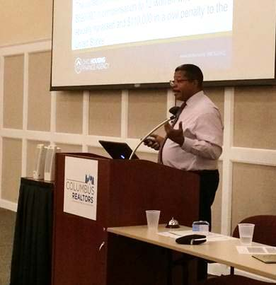Photo of Director of Housing Ronnell Tomlinson speaking at training